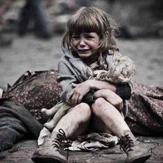 Nothing with this image but it's plain to see a body behind the little girl and the pain an fear on her face made me cry. Weather natural or manmade this picture is heartbreaking. N