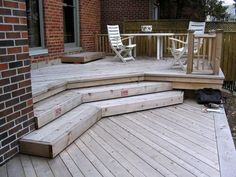 two tiered deck with different sized deck boards running diagonally and perpendicular to each other (view from lower level)