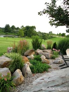How To: Landscaping with Rocks. This would work really well on the grassy area under the west facing garage wall. Or on the cement area by the front porch.