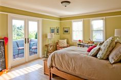 Wood trim with a shade darker at the top...draws your eye up and makes ceiling look higher!