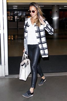 Jamie Chung makes comfy look cool with a printed coat, leather pants and lace up shoes.... - Celebrity Street Style