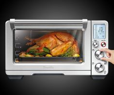 """Tons of toaster ovens do more than just toast, but I like the Breville Smart Oven Air's additions of frying and dehydrating to the countertop cooker game. Using Element IQ technology, or the thing that allows them to put """"Smart"""" in the name, the oven ca"""