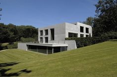 Two concrete cubes, The Uccle House by Marc Corbiau.