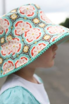 oliver + s bucket hat with widened brim and mini pom poms!