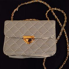 Francesca's Striped Cross Body Bag Francesca's Striped Cross Body Bag. I believe the color is navy and white, but could be black and white. I honestly have terrible vision. Can also be carried as a person by adjusting straps. Francesca's Collections Bags Crossbody Bags