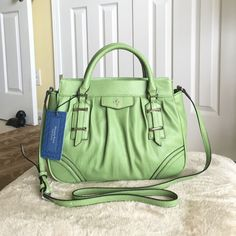 """Authentic Vera Wang Satchel Bag Authentic Vera Wang Satchel Bag. Style ASVH1542-0501 Calgary Satchel bag. Color- Green eyes. New with tag. Made of faux leather. Its a magnetic pin top closure purse with middle zip top closure compartment as divider. It has fabric inside lining & multifunction slide pockets & zip pocket. Dimensions- 12"""" L x 9"""" H x 5"""" W with handle drop height of 3.5"""" and long adjustable strap of 23"""" drop height. No dust bag available. Vera Wang Bags Satchels"""