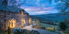 This renovated farmhouse and cottage is is surrounded by rolling hills and tumbling waterfalls.