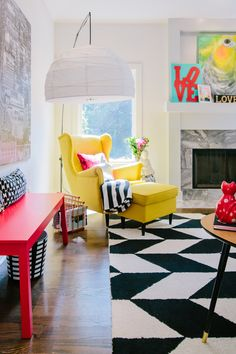 The Creative, Bold & Colourful Home of Paola Roder | Living room seating area using vibrant colour palette and bold pattern to create visual energy and an element of fun. Paola's graphic design background is shown through all her decor choices.  #housetour #vibrantinteriors #colourinspo #colourfulinteriors #interiordecor #homedecor #interiordesign #livingroomideas #colourfullivingroom #theinterioreditor #boldinteriors #colourfuldecor #interiors #homeinspo #livingroomdecor