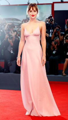 DAKOTA JOHNSON in a pink Prada dress at the premiere of Black Mass in 2015