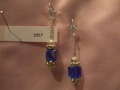 royal-blue crystal cube with silver rondelles and filigree beads accenting both ends