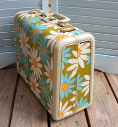 Fabric covered vintage suitcase.