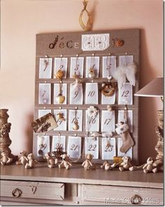 Linen advent calender with Christmas tree ornaments.