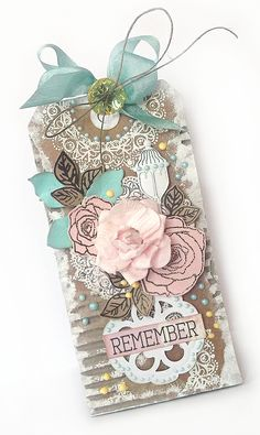 Karola Witczak  Love the black ink roses on the light pink paper! Beautiful tag!