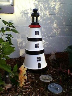 This is a Clay pot Lighthouse that I created (MimiRose), with IKEA lantern on top - holds one tealight candle