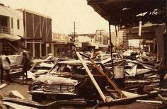 A trashed car and debris litter Smith Street as a result of Cyclone Tracy. Albert A. Dixon Collection.