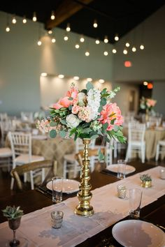 This gorgeous detail shot by Nicole Ryan of Sweet Magnolia's tall centerpieces at Canyonwood Ridge is absolutely stunning. #austinweddingplanner #drippingspringswedding #heavenlydayevents #hillcountry #centerpiece #tallcenterpiece