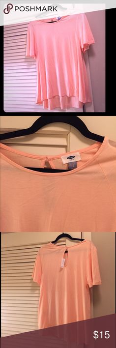 Brand new loose fit peach top Super cute loose fitting t shirt top. Both casual but the cut is styled so it feels like you are wearing a t shirt but you look super cute! Brand new with tags. Also comes in a navy (see other postings). Old Navy Tops Tees - Short Sleeve