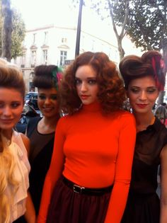 Highly coiffed models taking a break from their Carita Beauty Institut Disco Moves