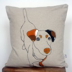 The inspiration for Naughty Dog came after her brother's naughty Saluki dog ate her pyjamas. To commemorate the event, she decided to make a cushion with this much loved dog as a Christmas present and have been making them ever since. Applique Dog Cushion by florencev4 on Etsy,