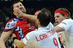 Belgrade, Serbia — Serbia's Marko Vujin, left, is stopped by Denmark's Lars Christiansen and Mikkel Hansen, right, during the men's EHF Euro 2012 Handball Championship final. Denmark defeated the host Serbians for the gold medal, 21-19.