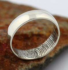 A fingerprint-engraved wedding band that could only be for him. #etsyweddings