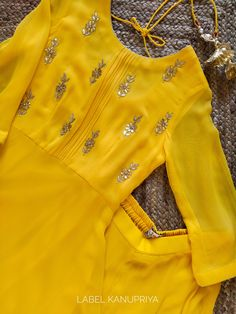 Yellow Frock Style Gota Patti Sharara Set - - Golden Gota Patti floral motifs sprinkled all-over the bodice Three-quarter sleeves … www.labelkanupriy… … Source by rinkugohel Dress Indian Style, Indian Fashion Dresses, Indian Designer Outfits, Indian Outfits, Indian Wear, Designer Dresses, Churidar Designs, Kurta Designs Women, Blouse Designs