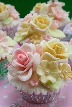 Adorable blooming cupcakes!  Pretty enough to be part of a wedding reception centerpiece!