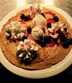 Dutch pancake with whipped Cream, vanilla ice, sweet cherries
