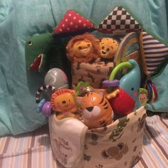 Jungle animals diaper cake Jungle receiving blanket Onesies 0-3 months  Stuff lion n cheetah rattle  Elephant rattle  Toy stuff lizard rattle toy Lion bib Elephant book Pacifer  Diapers metal in plastic with ribbon  Bottle lion rattle Other