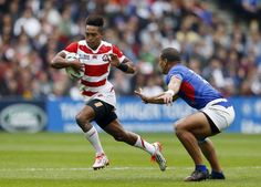 Japan's Kotaro Matsushima competes against Samoa at the Rugby World Cup on Saturday.   REUTERS
