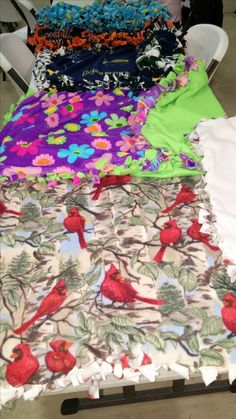 """Simple no sewing , cut tie lap blankets our class made! Super Easy!We donated them to a local retirement community. Step 1: select two kinds of soft fabric. One for the front and one for the back. 1 yard each. 2. lay out the fabric so there is no folds or wrinkles 3: pin the fabric together. place the pins about 4 1/2 inches from the edges. 4: cut about 1/2 inch around edges to even them up 5: Cut a 4X4 Inch Square from all the corners 6: Cut 3.5""""X1"""" stripes 7: Tie double knots in strips…"""