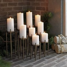 """Ana Reza-Hadden's architectural candelabra hoists nine pillar candles on graduated risers, elevated on long, lean legs. Handcrafted candleholder's dramatic, linear style gets a soft touch with a warm, antiqued brass finish.<br /><br /><NEWTAG/><ul><li>Designed by Ana Reza-Hadden</li><li>Iron with antiqued brass finish</li><li>Accommodates nine pillar candles up to 3""""-diameter, sold separately</li><li>Made in India</li></ul>"""