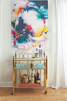 Bar carts serve as stylish yet hardworking hubs for entertaining. Learn how to style your beverage station with these beautiful bar cart ideas. #barcart #barcartstyling #barcartideas #barcartdecor #bhg Bar Cart Styling, Bar Cart Decor, Outdoor Bar Cart, Vintage Bar Carts, Favorite Paint Colors, Black Table Lamps, Dose Of Colors, Colorful Artwork, Wooden Bar