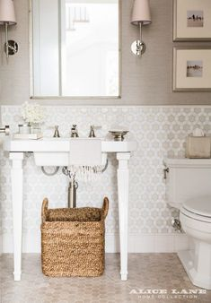 Tonal poweder bathroom with pedestal sink and tiled floors and walls Coastal Contemporary - Alice Lane Home Interior Design