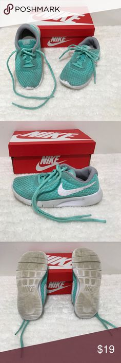Pre💜Girls 12.5 Turquoise/White-Gray Tanjun Nike Preloved in GUC •Please see the pictures-left shoelace is missing plastic end tip, they do have some stains & are in used condition. I have washed & air dried them. Original box will be included, please note it does have some tears on it. Comes from a smoke & pet free home, thanks for stopping by closet Happy Poshing💞 Nike Shoes Sneakers