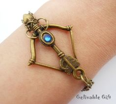 Steampunk bow and arrow bracelet with blue crystal and double chain