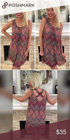 Fully lined spring color cross back petite dress! Beautiful in pinks and shades of plum with a taupe background- pretty tribal print- hi crisscross in back - swing cut - fully lined Dresses