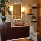 modern sink bowl, tiled wall above vanity, plants make a tranquil settingPhoto by: J. Powless Fine Cabinetry