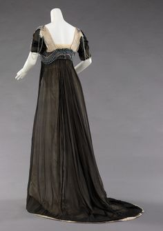 "Evening Dress, Attributed to Jean-Charles Worth (French, 1881–1962) and/or Attributed to Jean-Philippe Worth (French, 1856–1926) for the House of Worth (French, 1858–1956): ca. 1909-1911, French, silk, metal, glass. ""The beadwork here is rather exceptional with the curving line over the bust which is elegant and seductive. The tastefulness is in line with the general high taste level of the owner of the dress..."""