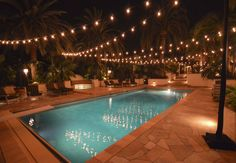 Hang patio string lights above an outdoor pool. The reflection is gorgeous! Hang patio string lights above an outdoor pool. The reflection is gorgeous! Backyard pool l Backyard Lighting, Outdoor Lighting, Landscape Lighting, Lights In Backyard, Exterior Lighting, Garden Lighting Ideas, Lighting Cable, Lantern Lighting, Outdoor Hanging Lights