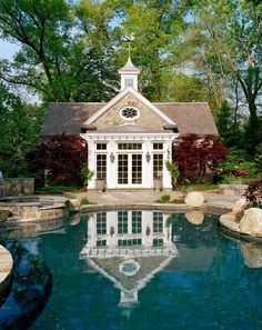 Complementing a natural free-form pool, this stone and wood clad Colonial style pool house offers an inviting copper-roofed pergola. Outdoor Rooms, Outdoor Living, Living Pool, Pool House Designs, Saloon, My Pool, Dream Pools, Beautiful Pools, Cool Pools