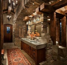 """This dreamy mountain retreat called the """"Great Northern Lodge"""" was designed by Centre Sky Architecture, located in Whitefish, Montana. Rustic Ceiling Light Fixtures, Ceiling Lights, Rustic Lighting, Rustic Bathroom Designs, Rustic Bathrooms, Log Home Decorating, Decorating Kitchen, Cabin In The Woods, Rustic Room"""