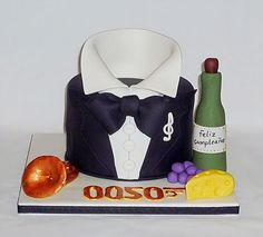 James Bond themed 50th birthday cake tailored to his favourite things - handmade sugar French horn, wine and cheese too by EvaRose Cakes