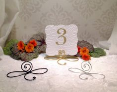 Infinity table number holder wedding table number stand set of 6 24 silver infinity bow wire name place cards or small table number holders silver table number stands greentooth Gallery