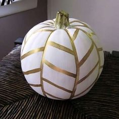 Herringbone Pumpkin This pumpkin is so simple, we don't know why everyone doesn't try it! Paint your pumpkin a lighter color, and then accent it with a herringbone pattern in a contrasting color. Classy!