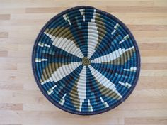 This sisal, woven bowl is approximately 12 in diameter and 100% handmade by our artisans in Gitarama, Rwanda in East Africa.