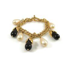 New to VintageVegasGems on Etsy: Faux Pearl and Black Drop Gold Tone Charm Bracelet (12.00 USD)