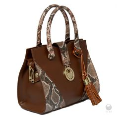 Ladies brown snake print faux leather tote bag    - Two-Tone matte and snakeskin print faux leather tote  - Removable FERI tassels  - Top strap closure with FERI plate  - Single zippered main compartment  - Gold toned customized FERI hardware  - Custom FERI lining    RETAIL PRICE ON OUR FERI WEBSITE AND AT OUR FASHION GALLERY IS $925. OUR EXCLUSIVE LIMITED TIME PRICE FOR SPREESY BUYERS IS $900    Leather is made in Italy, Portugal and Canada    Items are handmade and the stones are hand…