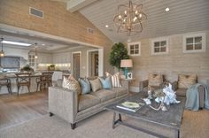 Contemporary Great Room with 9' easton collection, High ceiling, Laminate floors, Exposed beam, Pendant light, Chandelier