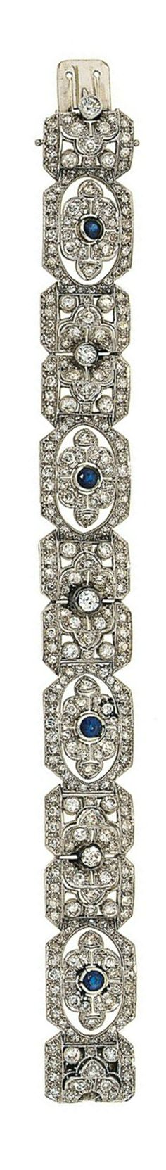 A sapphire and diamond bracelet  Composed of pierced panels of stylised flowerhead design, alternately-set to the centre with old brilliant-cut diamonds and circular-cut sapphires in single and old-cut diamond surrounds, 17.6cm long